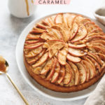 A spiced apple cake with apple sliced arranged on top and drizzled with salted maple caramel