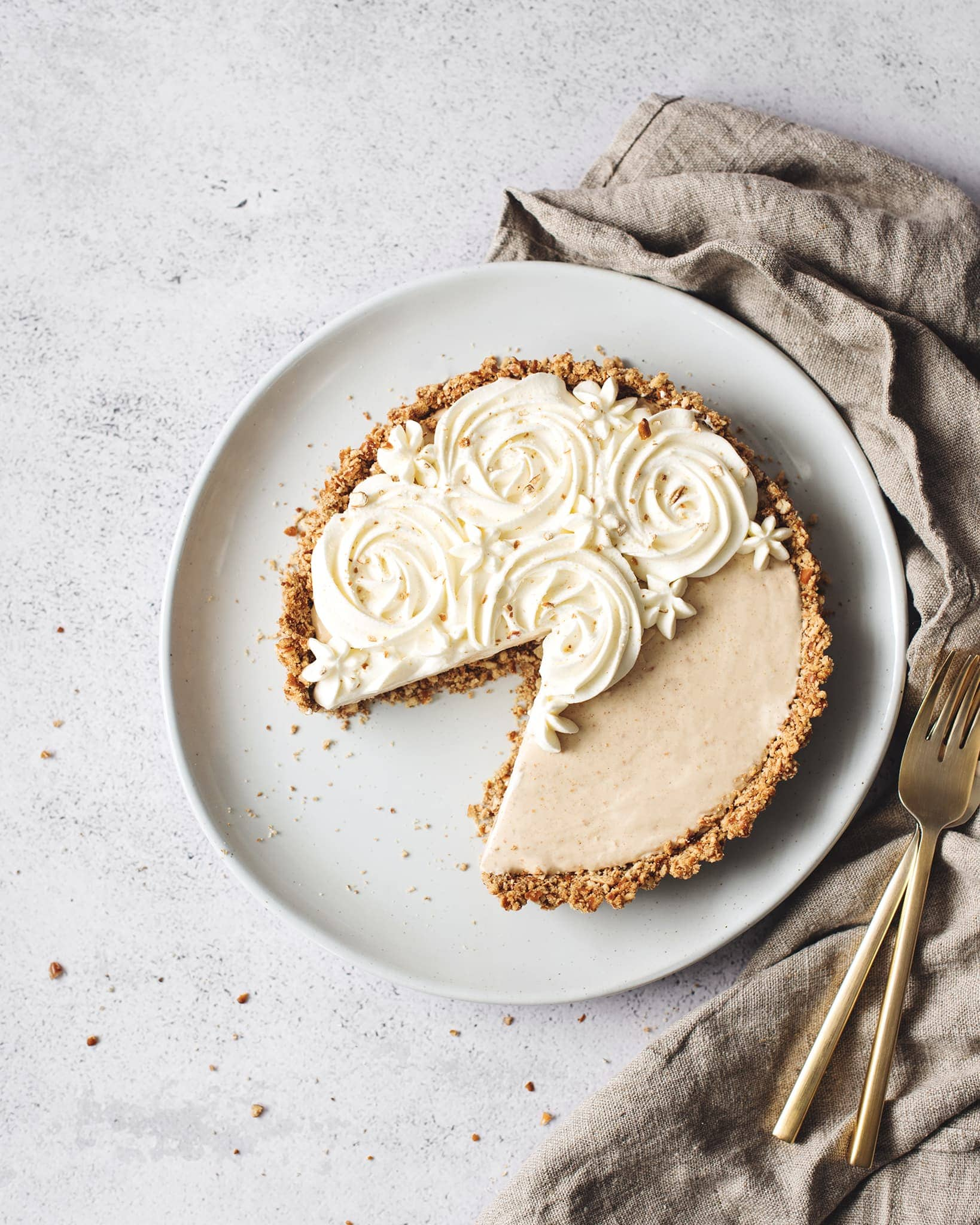 A slice cut out of a peanut butter ice cream pie