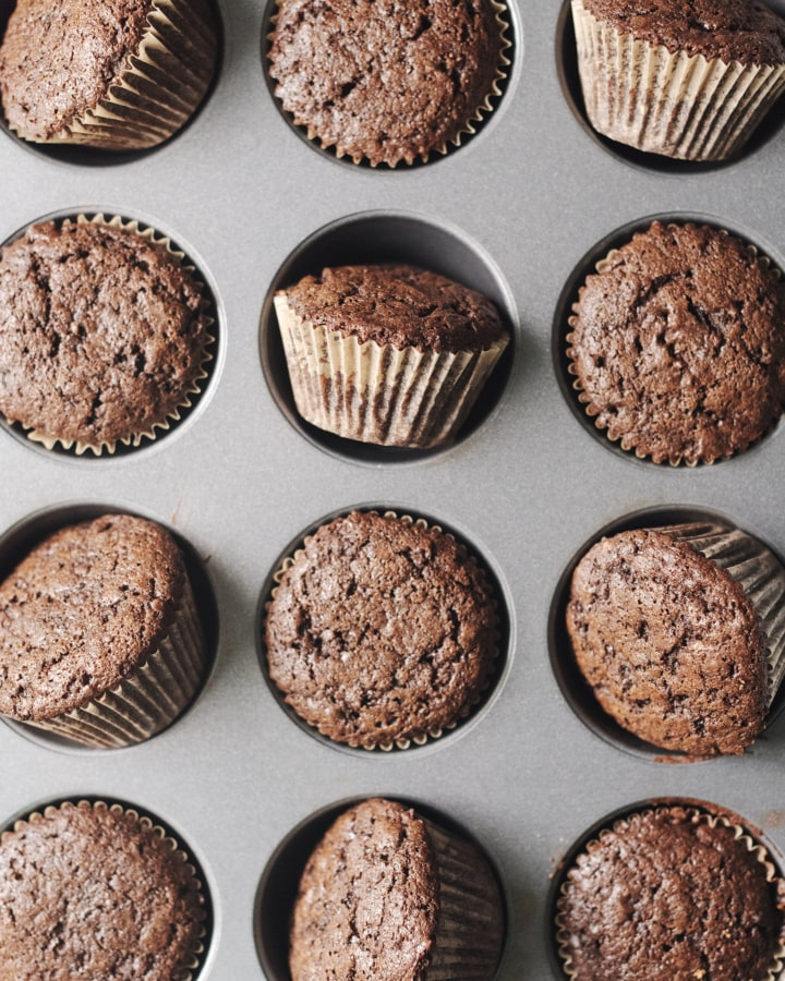 Chocolate cupcakes in a muffin pan