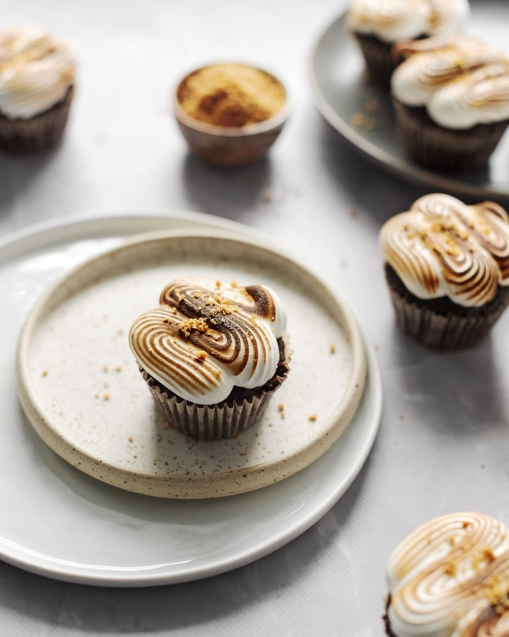 S'mores cupcakes with toasted marshmallow meringue on two plates
