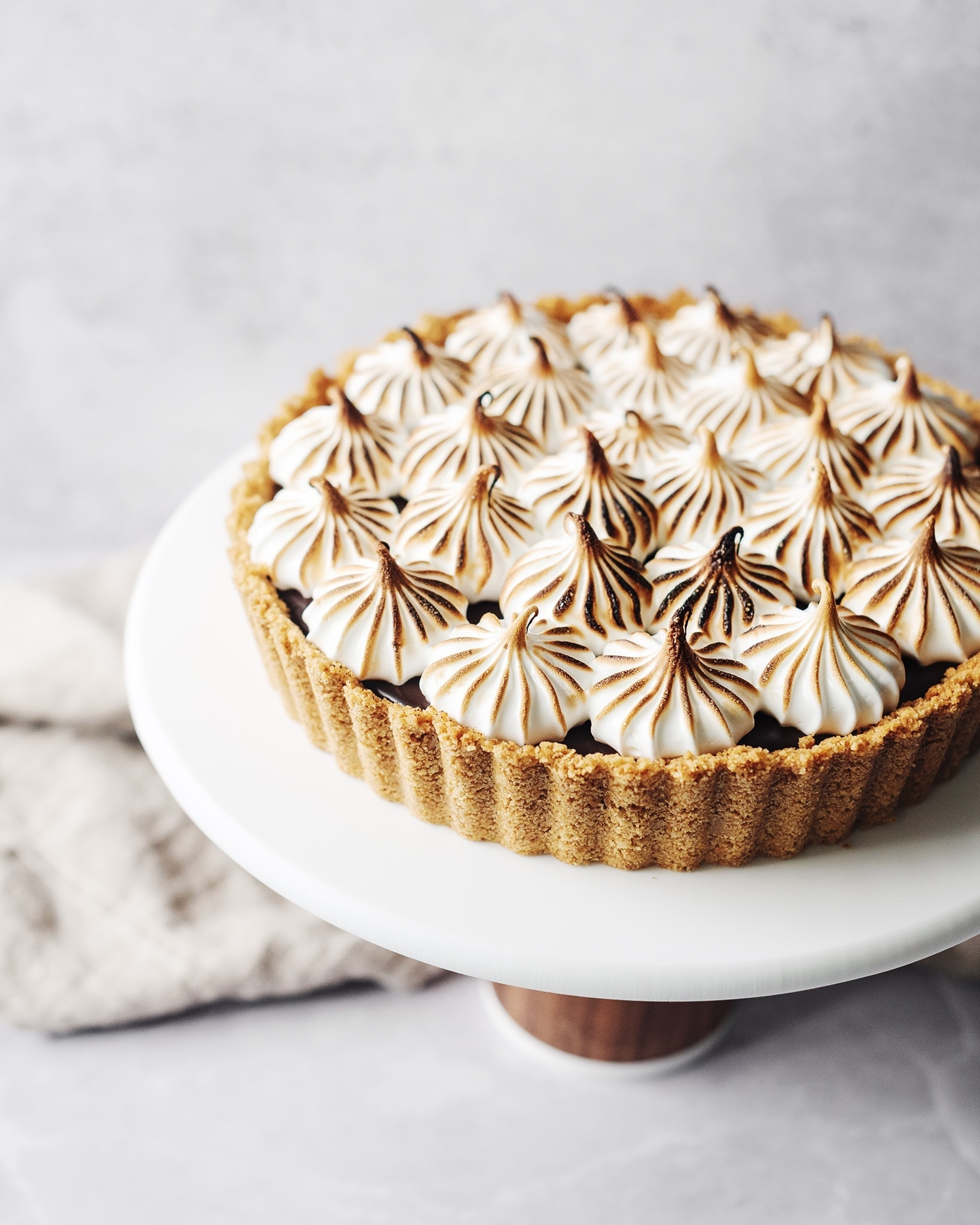 Toasted meringue on top of a s'mores tart