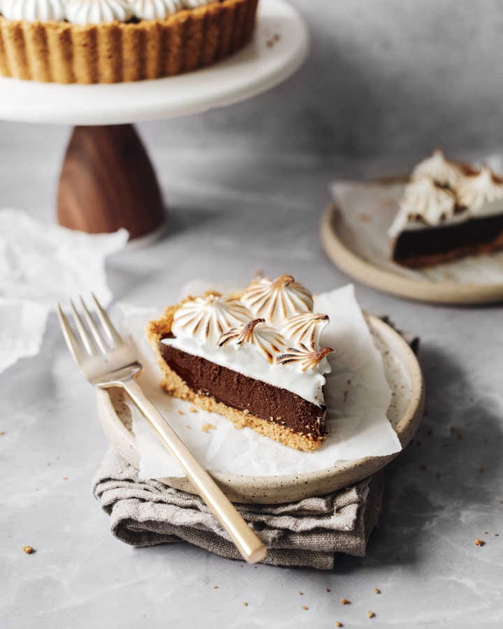 A slice of s'mores tart on a plate