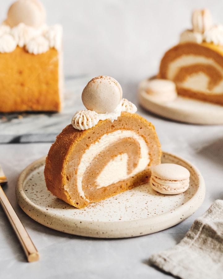 A slice of pumpkin swiss roll on a plate