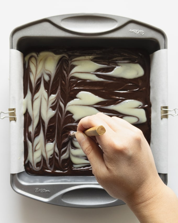 Marbling chocolate ganache pattern with chopstick