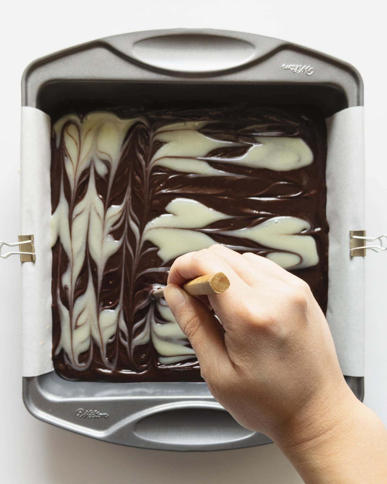 Marbling chocolate ganache pattern with chopstick