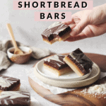 Hand holding shortbread bar with bite taken out of it