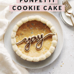 """Cookie cake with the word """"yay"""" piped in buttercream"""