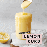 Spoon dripping lemon curd into glass jar