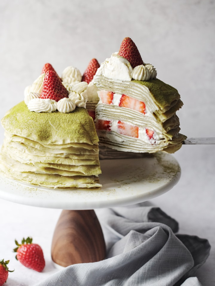 Lifting a slice of crepe cake from rest of cake