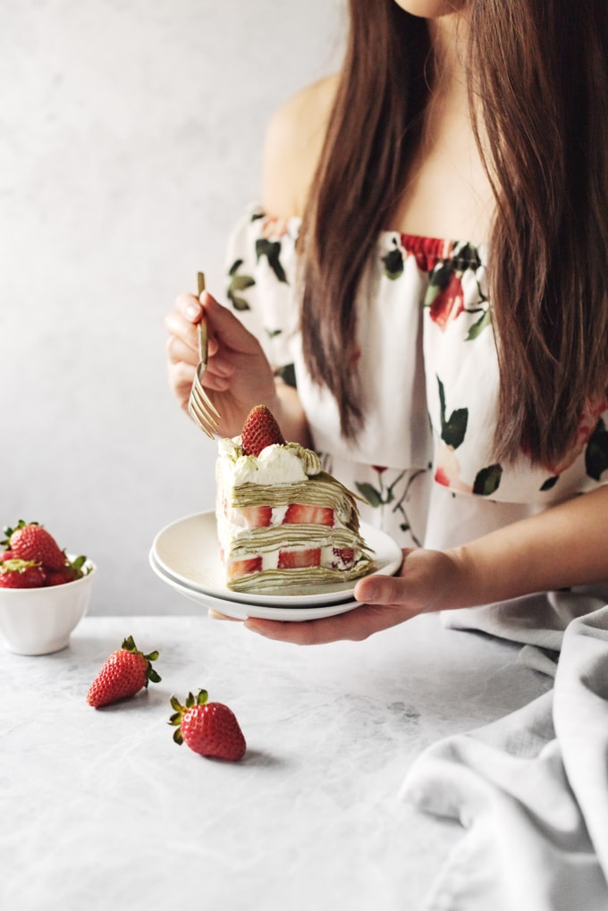 Girl holding slice of cake with gold fork