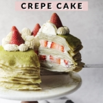 Lifting a slice of crepe cake from the rest of the cake