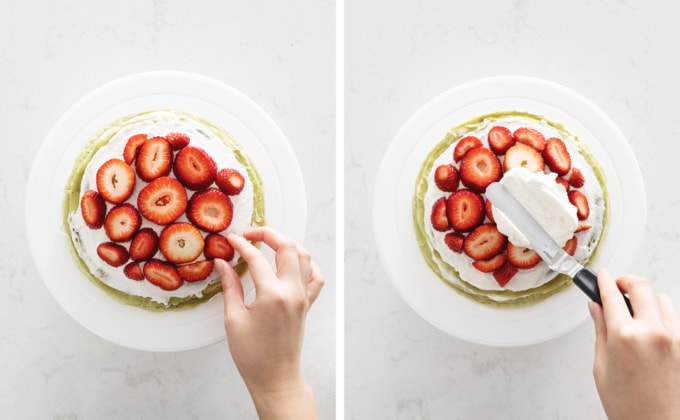 Slices of strawberries on top of whipped cream