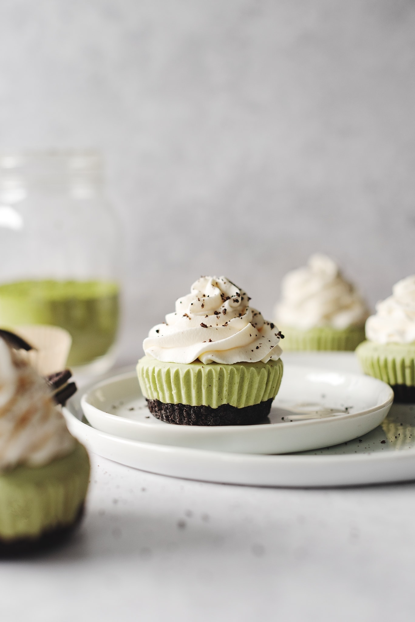 No-bake matcha cheesecake topped with whipped cream