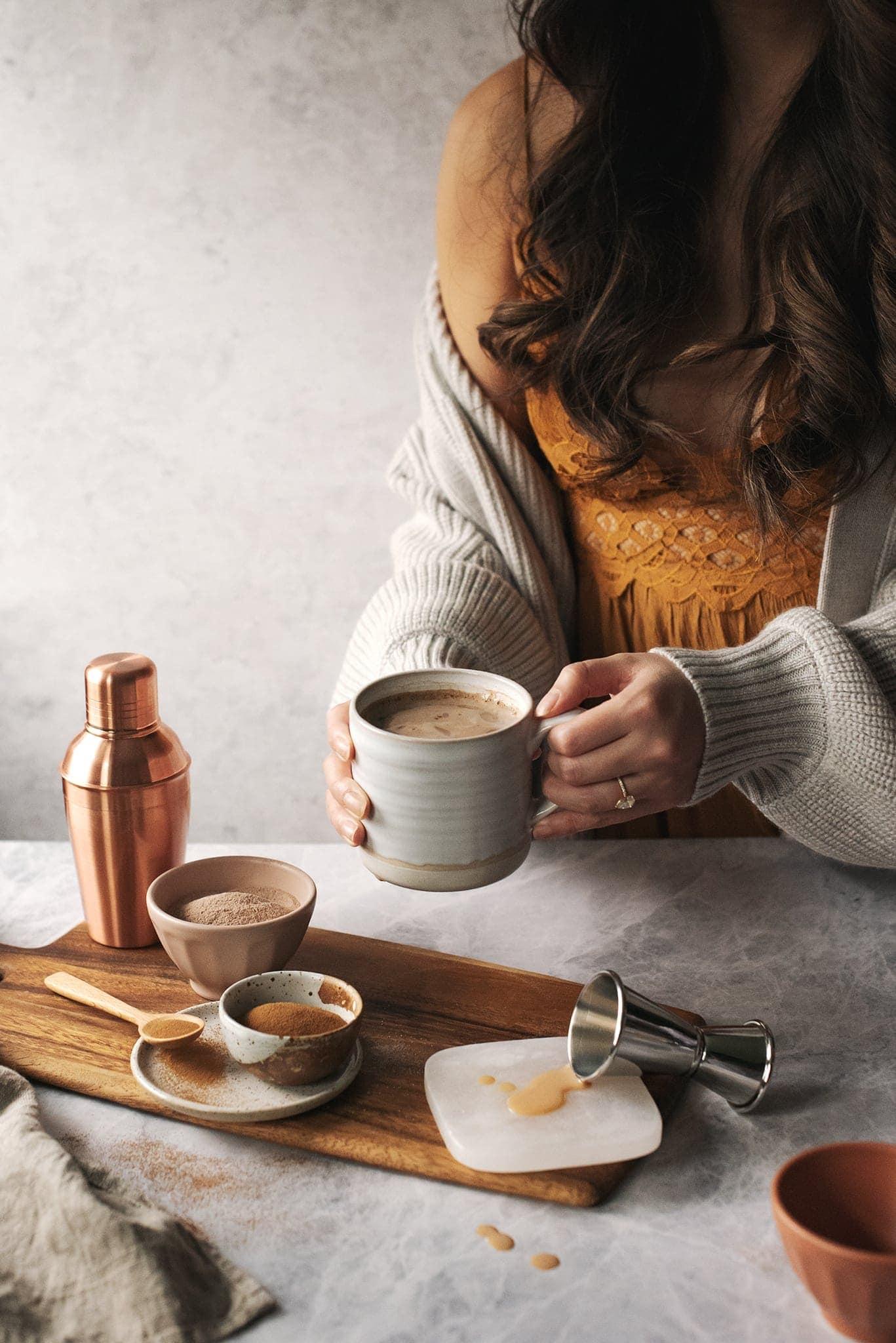 Hands holding a mug of Amarula caffè mocha