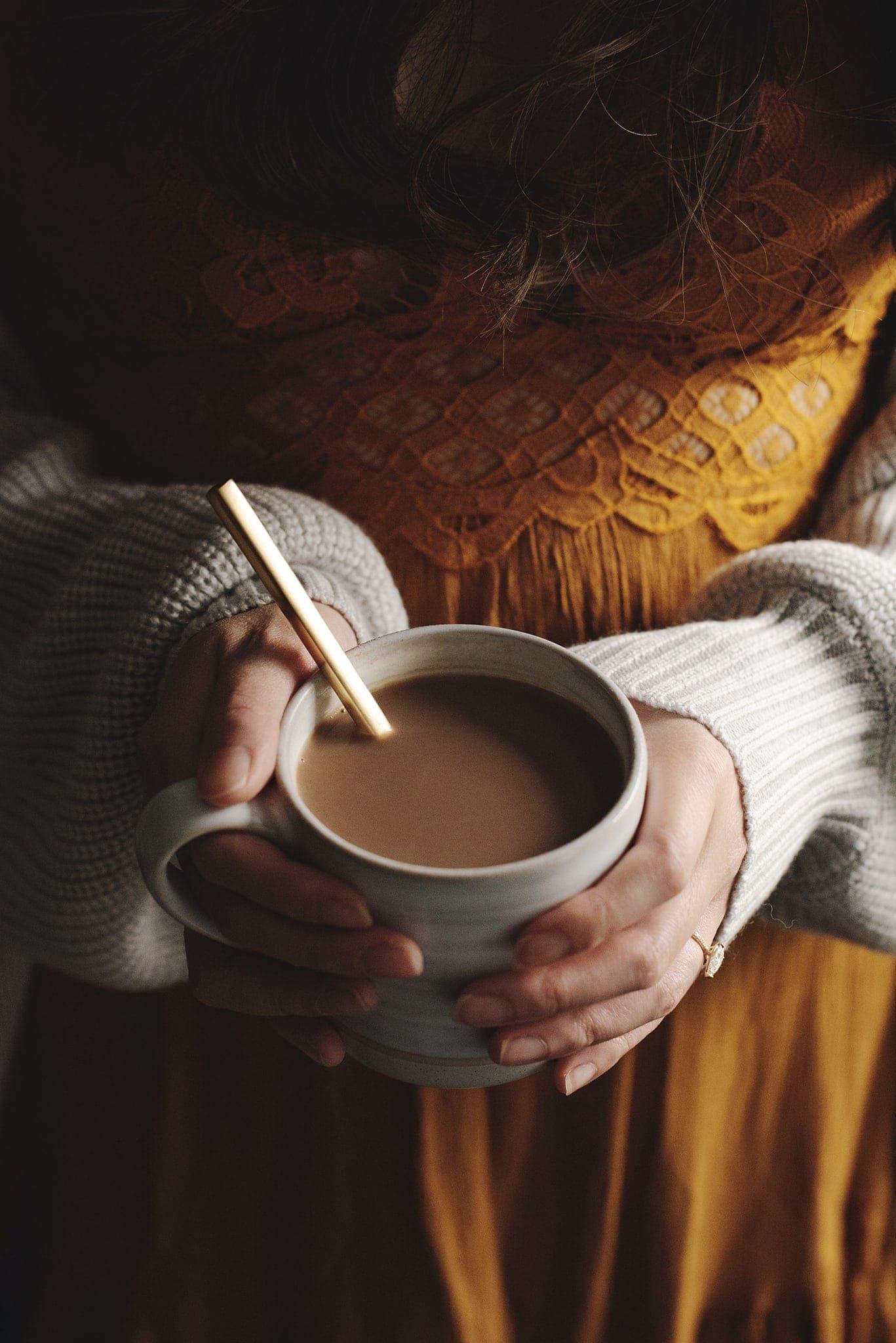 Holding a mug of Amarula caffe mocha in hands