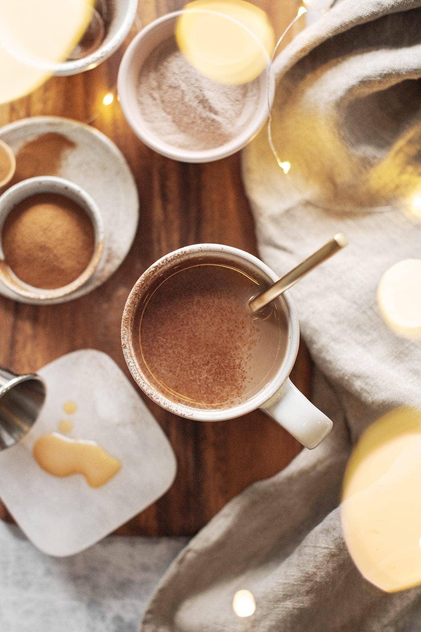 A mug of Amarula caffe mocha on wooden board with twinkle lights