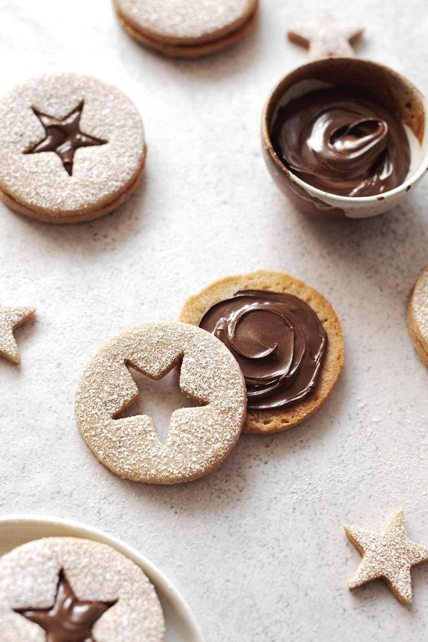 A swirl of hazelnut spread on inside of linzer cookie