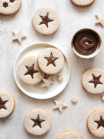 Hazelnut linzer cookies with star cut outs on table