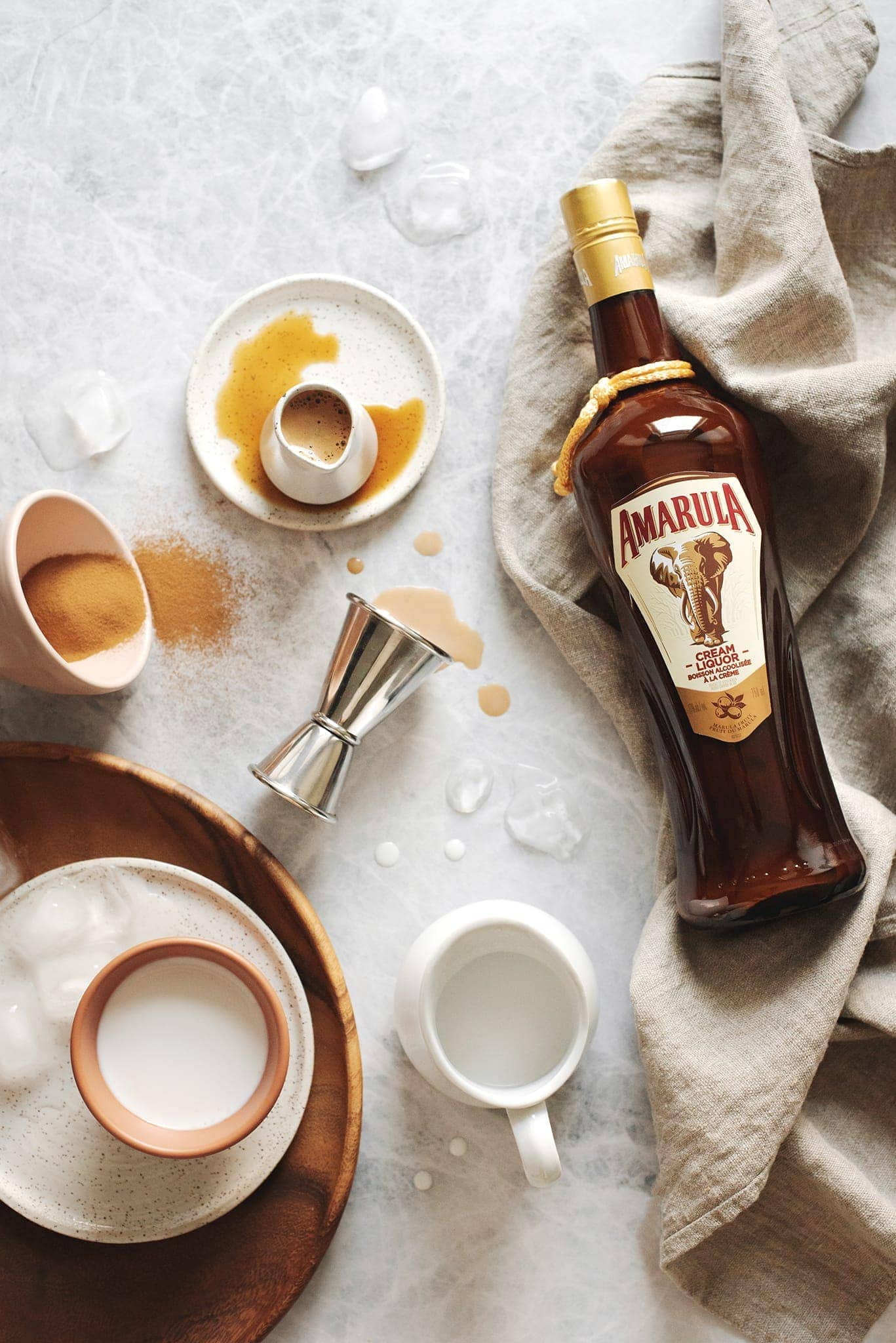 Amarula bottle and coffee spilled on table