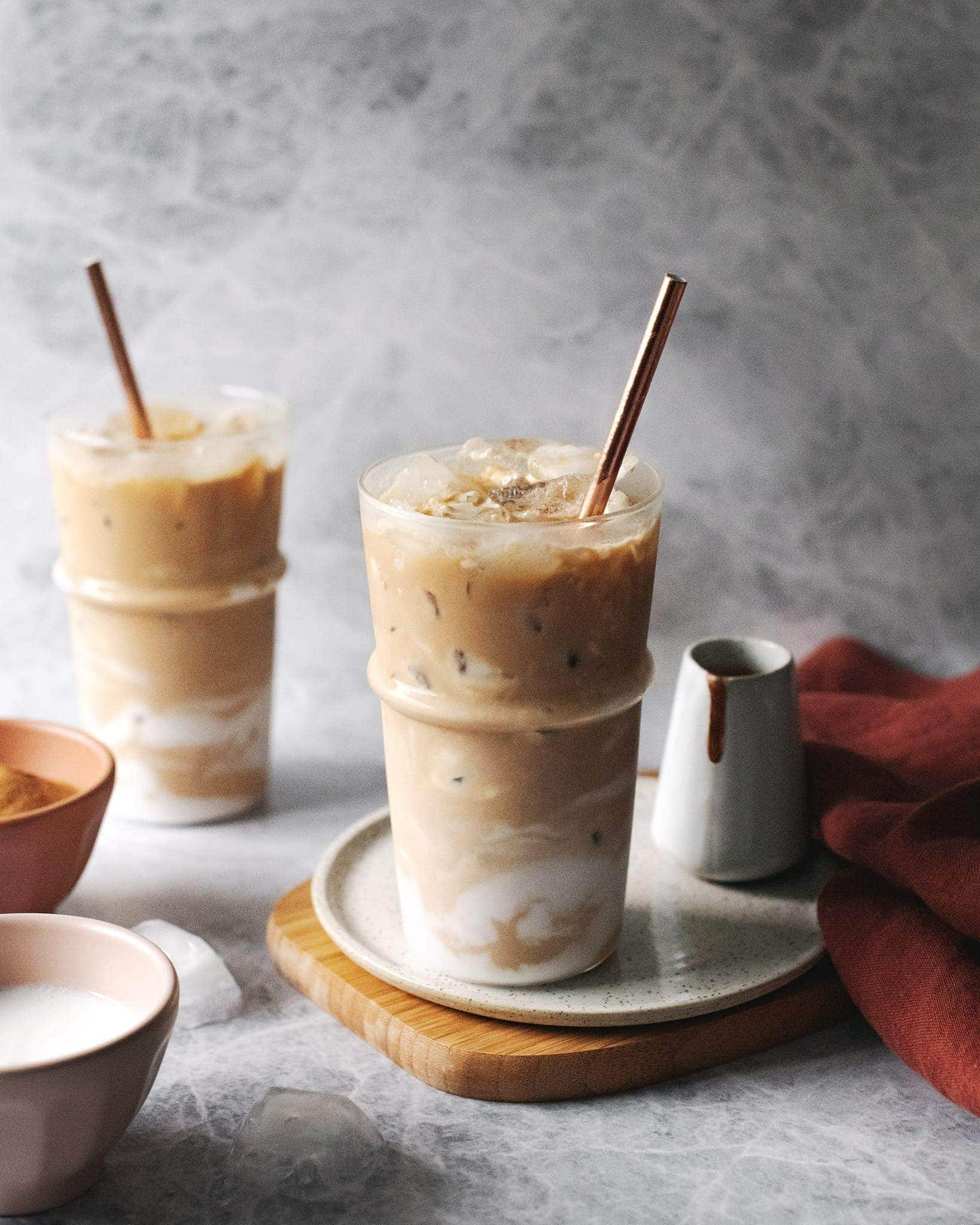 Two glasses of iced coconut Amarula latte with straws