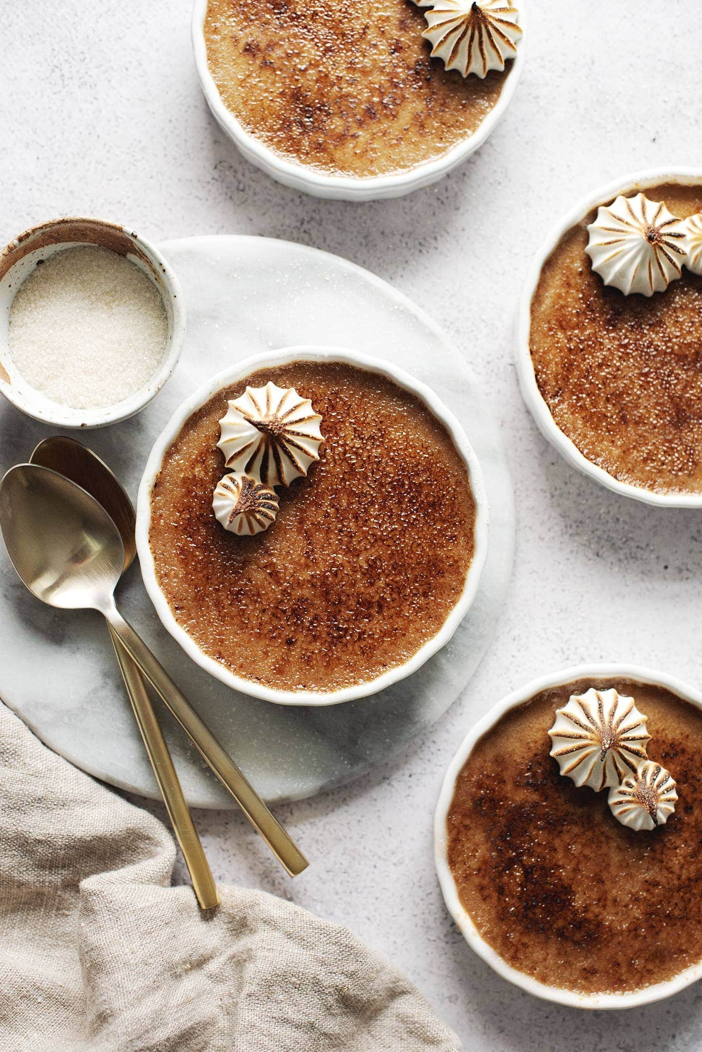 Pots of earl grey crème brûlée with torched surface