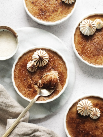 Spoonful of crème brûlée with caramelized sugar shards
