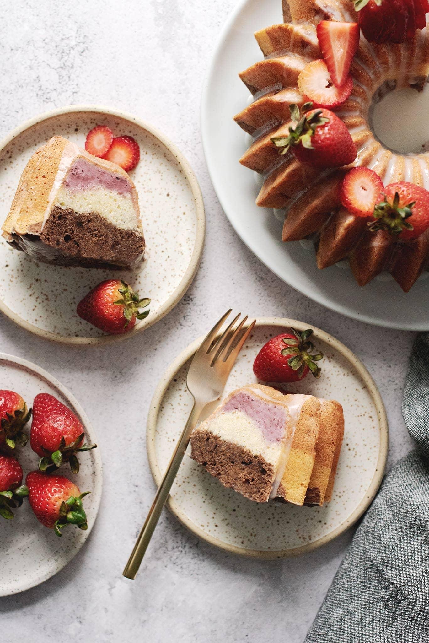 Slices of neapolitan bundt cake on plates
