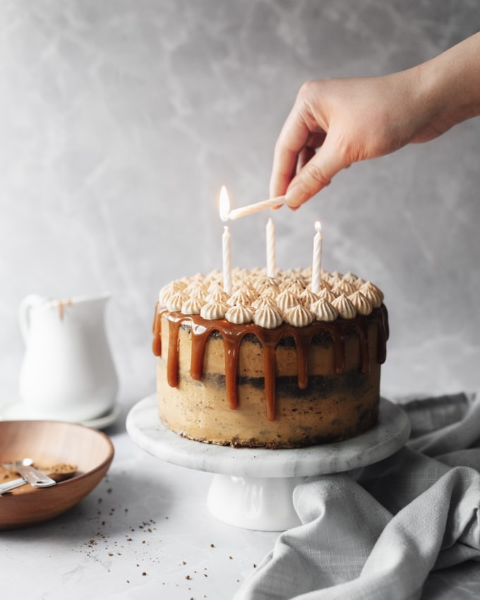 Lighting candles on a cake