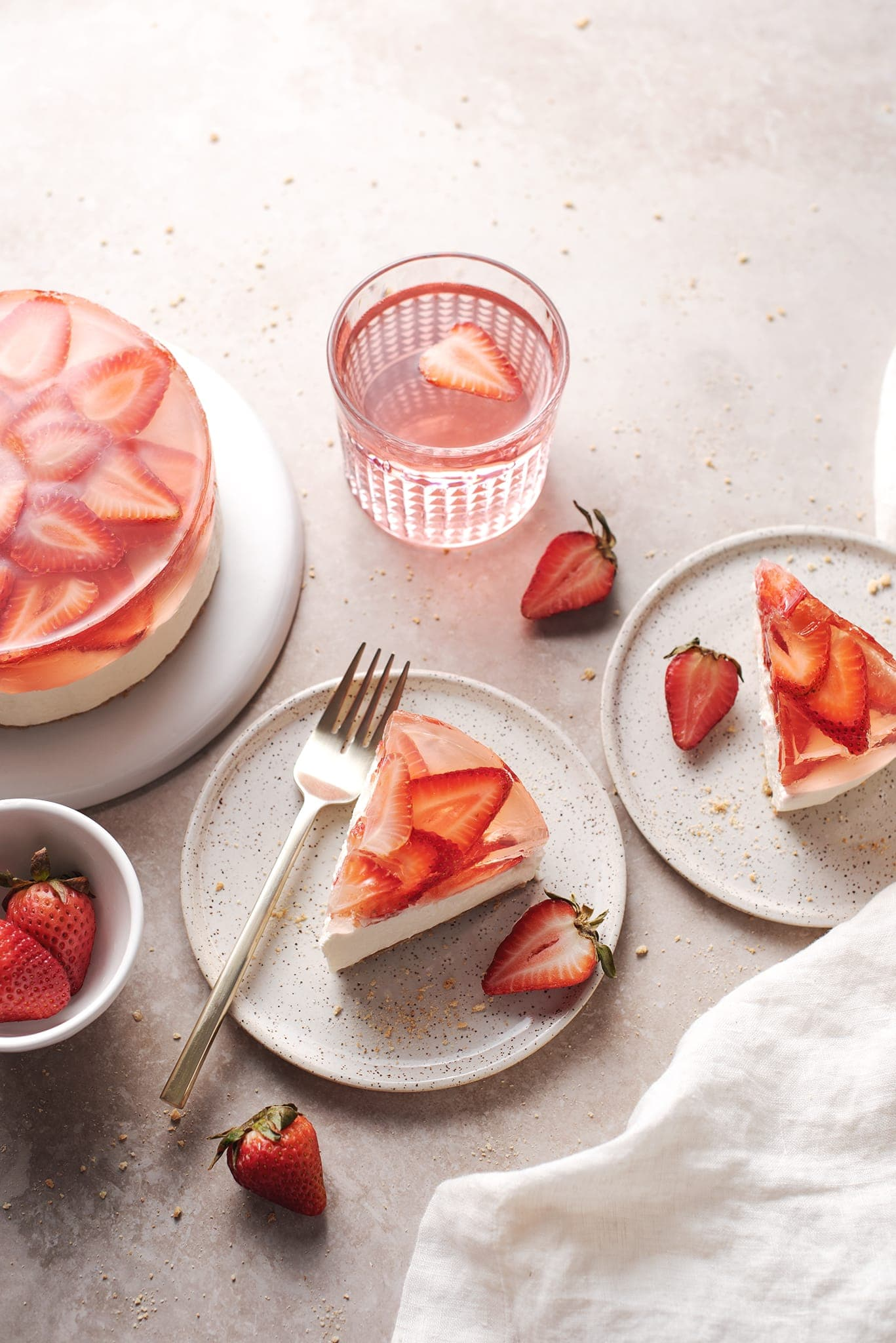 Slices of strawberry jelly cheesecake on small plates