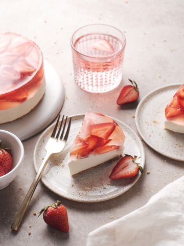 A slice of strawberry jelly cheesecake with translucent surface