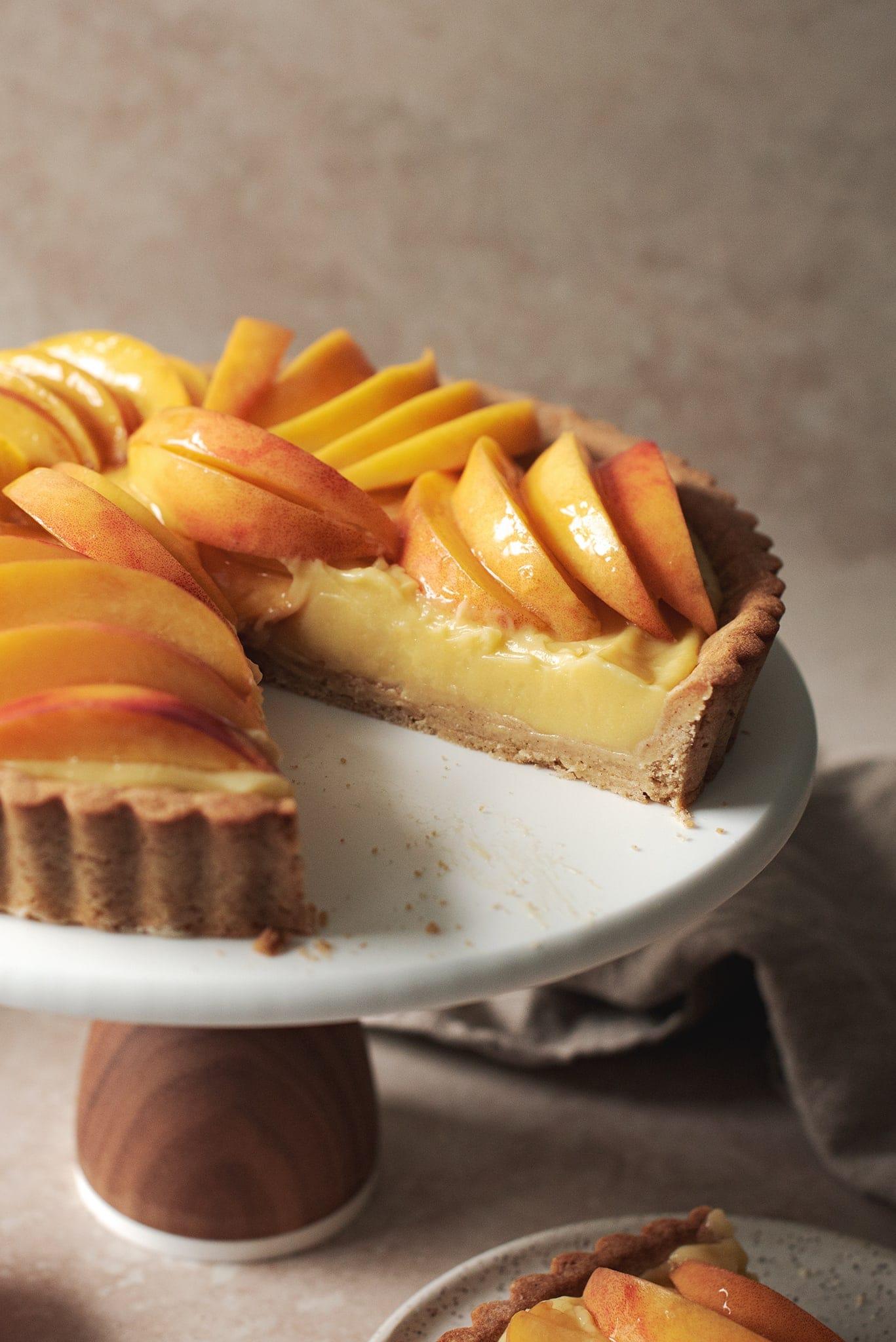 Custard pastry cream filling in a peach tart