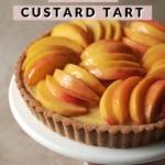 Slices of fresh peaches on top of custard tart
