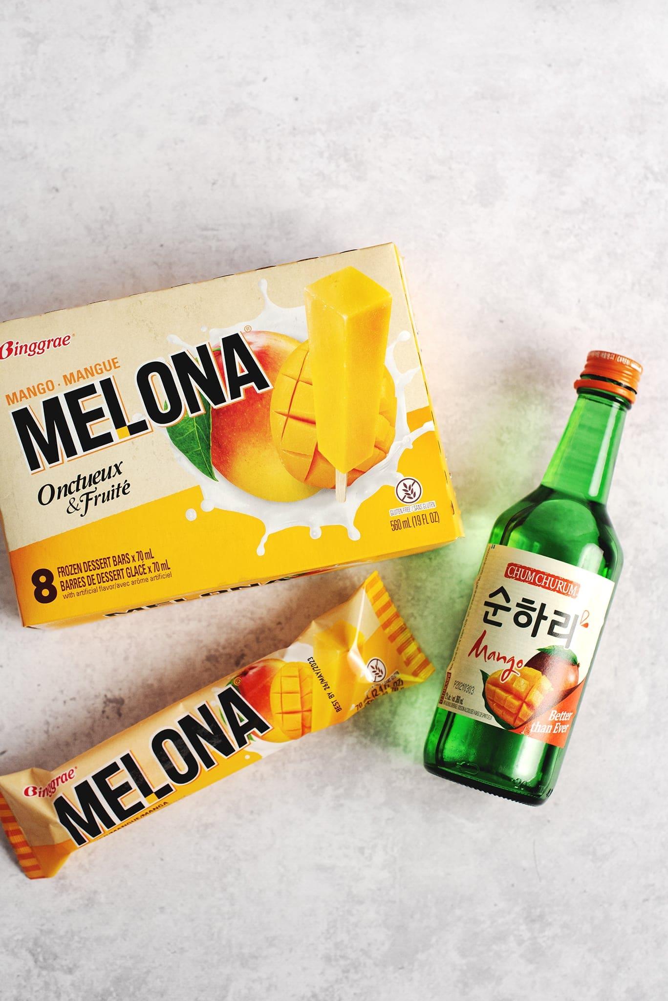 Box of mango melona bars and bottle of apple mango soju