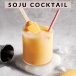 Mango melona soju cocktail with melona popsicle sticking out